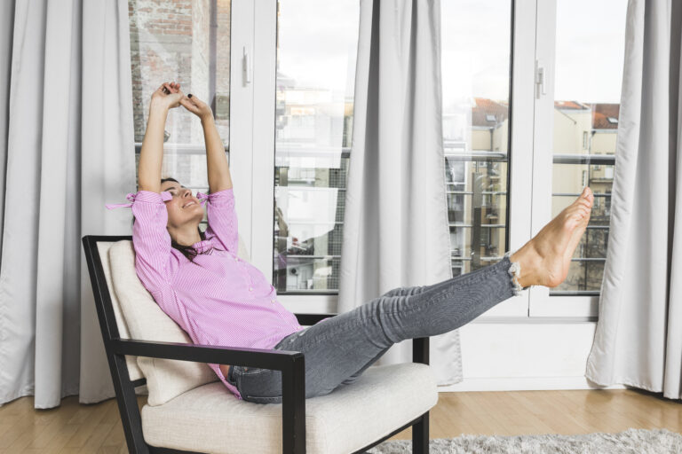 young-woman-sitting-chair-stretching-her-legs-body